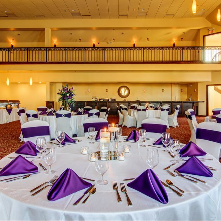 Banquet table set with purple accented linens