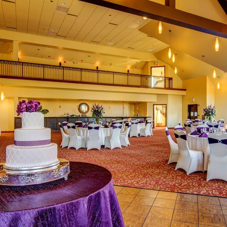 Event space set for wedding with purple accented linens