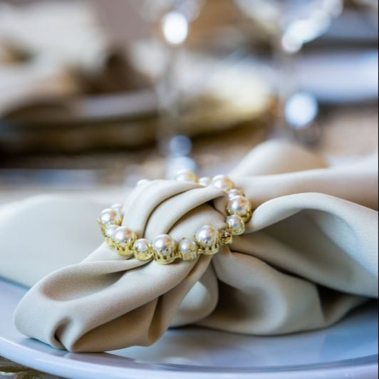 Close up of cream colored linens