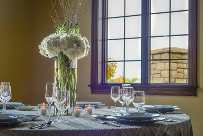 Elegantly set banquet table with floral centerpiece