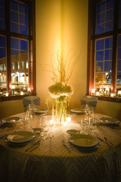 Candlelit banquet table with hydrangea centerpiece