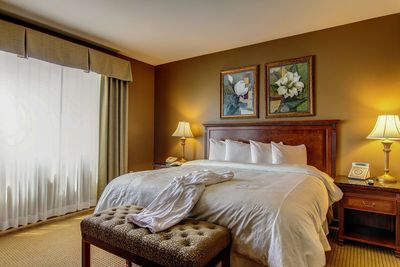 Welcoming king room with luxurious bathrobe