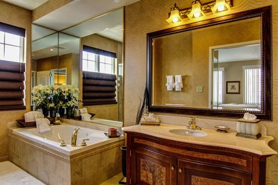Presidential suite bathroom with tub and large vanity