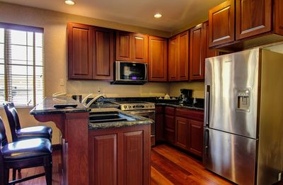 Presidential suite kitchen with full size stainless steel appliances