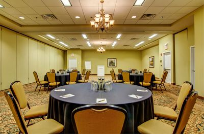 Meeting space set with navy linens on round tables