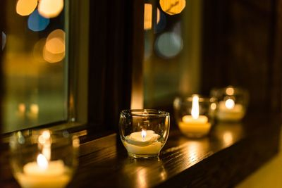 Tealight votives on window sill