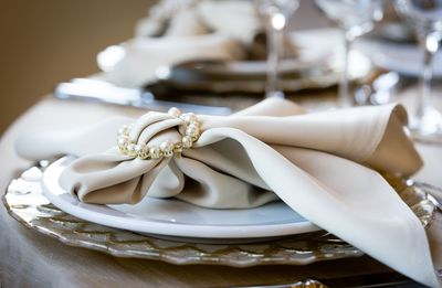 Classic table setting with cream napkin